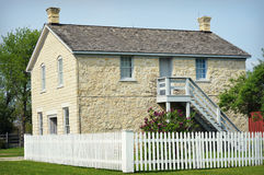 Stone Building with White Picket Fence Stock Photos