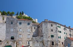 Stone built, attached houses of old Šibenik town. Stone built houses in hearth of old medieval Šibenik, Croatia Stock Photos
