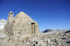 Stone built hut atop a mountain pass Royalty Free Stock Image