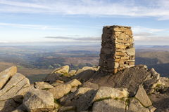 Stone built Trig Point. The stone built Trig Point on the summit of Moel Siabod Royalty Free Stock Photos
