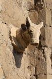 A stone bullish head on the gates stock photography