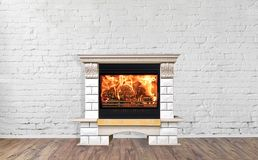 Stone burning fireplace in bright empty living room interior of house.  stock photography