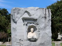 Stone bust of a well dressed elderly gentleman Stock Photos