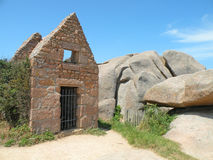 Stone Cabin. Old house ruins on the granite coast of France Stock Photo