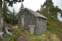 Stone cabin. In pacific northwest woods Stock Photo