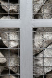 Stone cage. Wall stone cage with christian symbols stock images