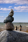 Stone Cairn 2. A dramatic stone cairn set against a blue sky Stock Photos