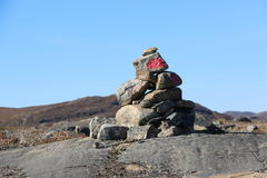 Stone cairn among Arctic Circle Trail ACT path. ACT is 160 km backcountry trail between Kangerlussuaq and Sisimiut. Greenland Stock Photos