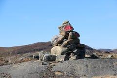 Stone cairn among Arctic Circle Trail ACT path. Stock Photos