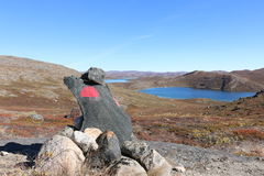 Stone cairn among Arctic Circle Trail ACT path. ACT is 160 km backcountry trail between Kangerlussuaq and Sisimiut. Greenland Stock Photography