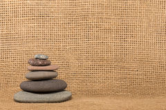 Stone Cairn on Burlap Background Stock Photos
