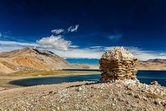 Stone cairn at Himalayan lake Tso Moriri, Royalty Free Stock Photo