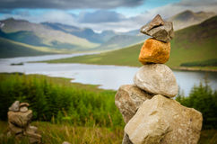 Stone cairn at loch loyne in Scotland royalty free stock images