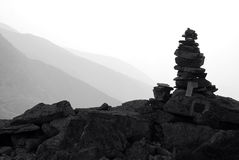 Stone cairn on a mountain Stock Images