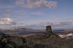 Stone cairn on a mountain Stock Image