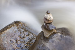 Stone Cairn River Blur Royalty Free Stock Photo