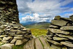 Stone cairn on Thornthwaite Crag. Sunlight on the Coniston Fells Stock Photo