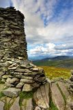 Stone cairn on Thornthwaite Crag. Sunlight on the Coniston Fells Royalty Free Stock Photo