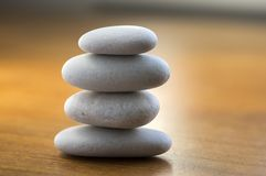 Stone cairn tower, poise stones, rock zen sculpture, light white pebbles. Four stones cairn tower, poise stones, rock zen sculpture, light white pebbles on stock photography