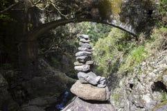 Stone cairn under the bridge, Rabacal, Madeira island, Portugal. Harmony and balance Stock Photo