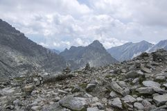 Stone cairns in Tatra mountains, Slovakia, harmony and balance under mount Rysy. Difficult terrain, stone way, cloudy Royalty Free Stock Photos