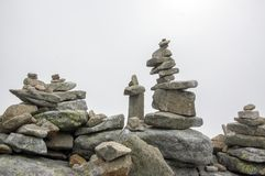 Stone cairns in Tatra mountains, Slovakia, harmony and balance under mount Rysy. Stone towers Royalty Free Stock Photography