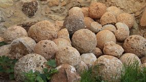Stone cannon balls in Ancient historic place. Historic place of Aptera on Crete Island Greece Stock Images