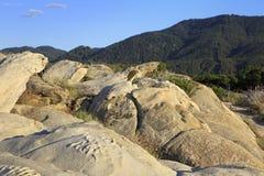 Stone cape Vourvourou Beach. Beautiful landscape. Stock Photo