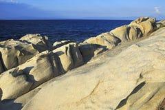 Stone cape Vourvourou Beach. Evening landscape. Royalty Free Stock Image