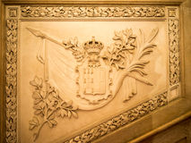 Stone carved blazon. Portuguese royal blazon carved in stone Royalty Free Stock Photos