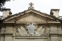 Stone Carved Coat Of Arms And Maltese Cross Above The Entrance. Of The Knights Hospitallers Church, Valletta, Malta Royalty Free Stock Photos