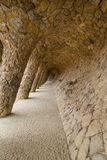 Colonnade passage at park Guell in Barcelona. Stone carved colonnade of Park Guell, designed by Gaudi, Barcelona, Catalonia, Spain. Architectural details Royalty Free Stock Photography