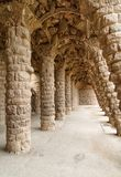 Colonnade arch of park Guell in Barcelona. Stone carved columns in colonnade of Park Guell, designed by Gaudi, Barcelona, Catalonia, Spain. Architectural details Royalty Free Stock Photos