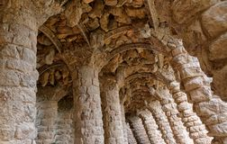 Stone carved columns, park Guell in Barcelona. Stone carved columns in colonnade of Park Guell, designed by Gaudi, Barcelona, Catalonia, Spain. Architectural Stock Image