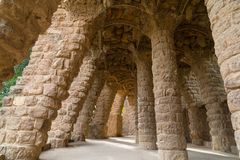 Stone carved columns at park Guell in Barcelona. Stone carved columns in colonnade of Park Guell, designed by Gaudi, Barcelona, Catalonia, Spain. Architectural Royalty Free Stock Images
