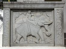 A stone carved elephant guard stone. A stone carved elephant guard stone adjacent to the Maha Vahalkada or Great Gate entrance to the Temple of the Sacred Tooth royalty free stock photography