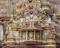 Stone carved erotic bas relief in Hindu temple in Khajuraho, Ind Stock Photos