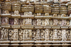 Stone carved erotic bas relief in Hindu temple in Khajuraho, Ind Royalty Free Stock Image