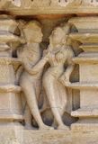 Stone carved erotic bas relief in Hindu temple in Khajuraho, Ind Stock Photography
