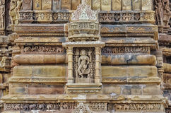 Stone carved erotic bas relief in Hindu temple in Khajuraho, India. Stock Photo