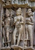 Stone carved erotic bas relief in Hindu temple in Khajuraho, India. Stock Photos