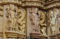Stone carved erotic bas relief in Hindu temple in Khajuraho, India. Royalty Free Stock Images