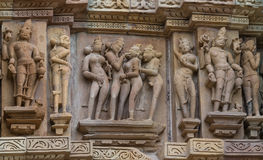 Stone carved erotic bas relief in Hindu temple in Khajuraho, India. Stock Photography