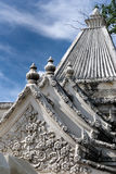 Stone Carved Flower on roof. The hand made stone carved flower creats a exquisite decoration on the roof of a building in Grand Palace in Bangkok Royalty Free Stock Photography