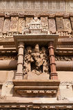 Stone carved sculptures of Male Deity on Kandariya Mahadeva temple. Khajuraho Royalty Free Stock Photo