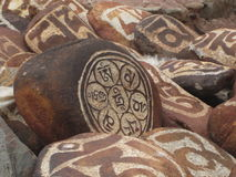 Stone carved with symbols of prosperity_2. Stone carved with symbols of prosperity 2 Royalty Free Stock Images