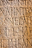 Stone carved writings. Roman stone carved writings and letters on a wall in Ephesus ruins in Turkey Stock Photo