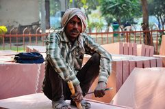 A stone carver poses near Delhi, India. Stock Images
