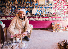 Stone carver at work small shop royalty free stock photography