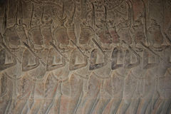 Stone carves in Angkor wat wall. Beautiful temples in Angkor wat area are really beautiful with wonderful architecture. Bayon face stock image